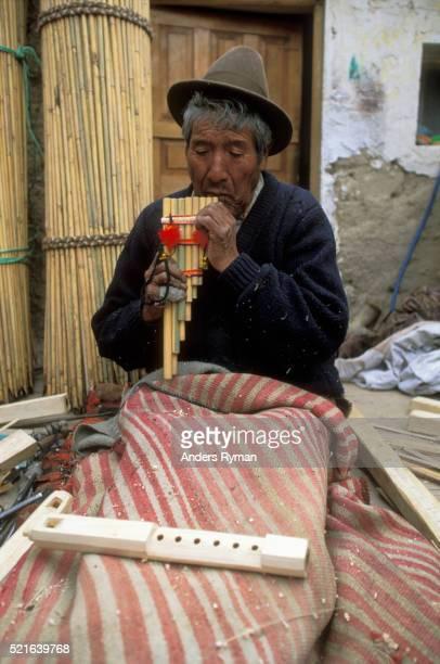 Instrument Maker Playing Panpipe
