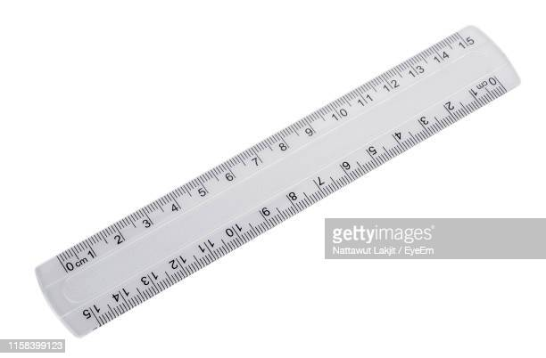 instrument of measurement over white background - rules stock pictures, royalty-free photos & images