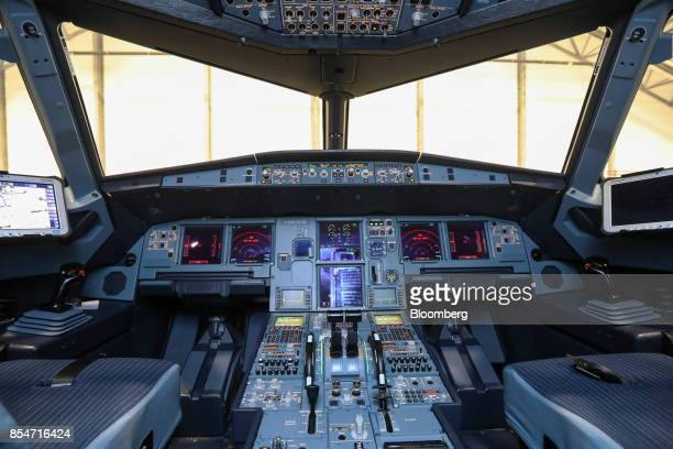 Instrument panels sit in the cockpit of an Airbus SE A320 Neo passenger aircraft during an the annual EasyJet Plc innovation day at London Gatwick...