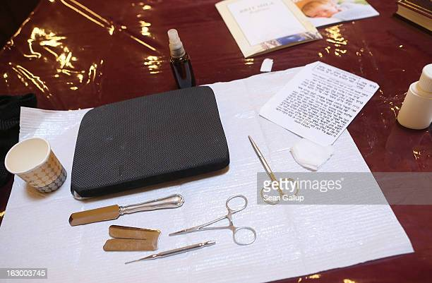 Instruments used in the Jewish circumcision ceremony lie on a table prior to the circumcision of baby infant Mendl Teichtal at the Chabad Lubawitsch...