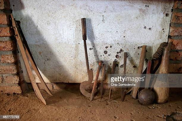 Instruments used to kill thousands, including crude farm tools, machetes, clubs, spikes spears and a canon ball, are displayed inside the Ntarama...