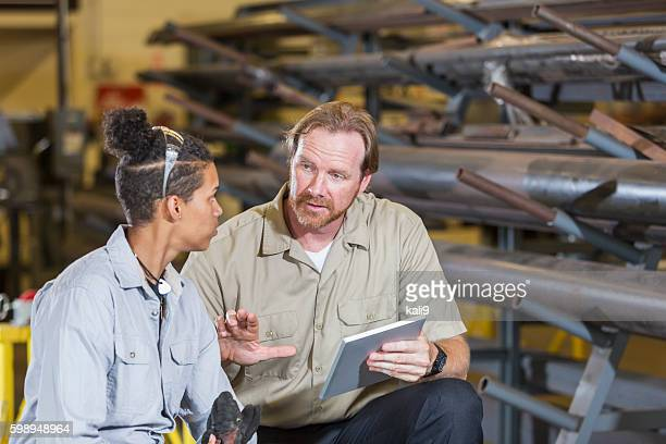 Instuctor and student in technical training school