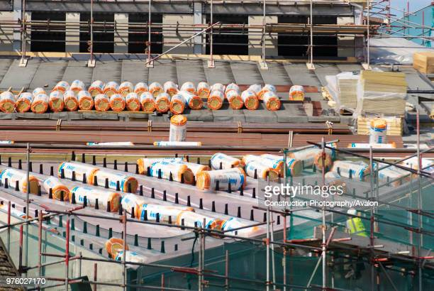 Insulation rolls on the roof during construction of the University of East Anglia campus building Ipswich Suffolk UK