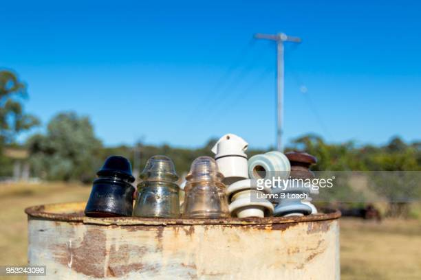 insulators on barrel - lianne loach stock pictures, royalty-free photos & images