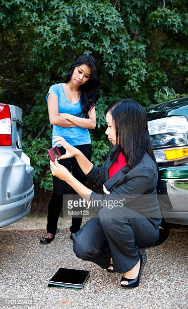 insurance adjuster photographing damage to vehicle - crash photos stock photos and pictures