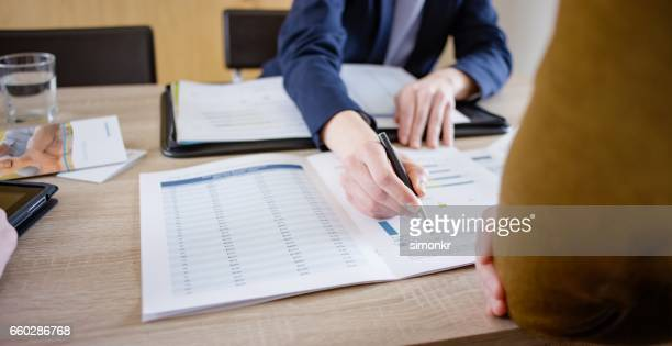 Insurance agent discussing with men