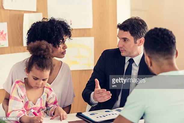 Insurance agent explaining contract to potential customers