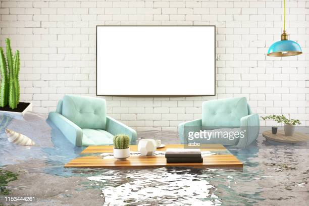 insurance concept. house flooded - damaged stock pictures, royalty-free photos & images