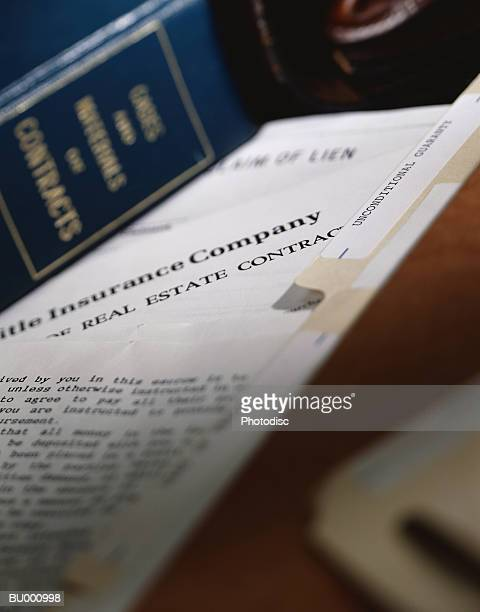 insurance contracts - deed stock photos and pictures