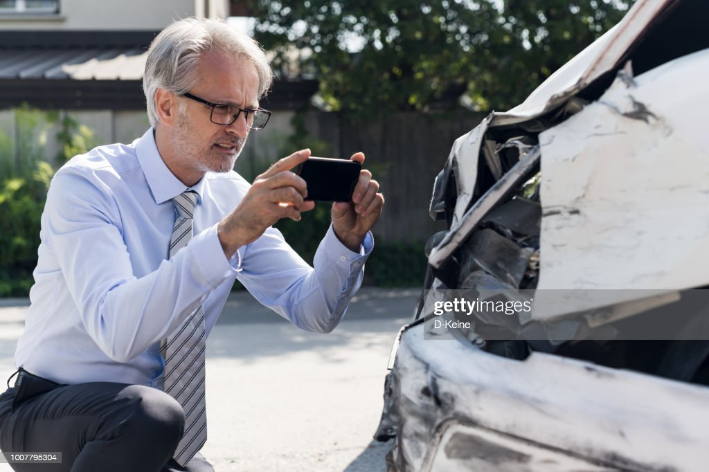 Insurance expert at work : Stock Photo