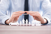 Insurance protecting family health live, house and car concept.