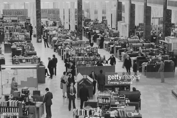 Insurance underwriters at work at desks known as 'boxes' at Lloyd's of London in Lime Street, UK, 22nd March 1978.