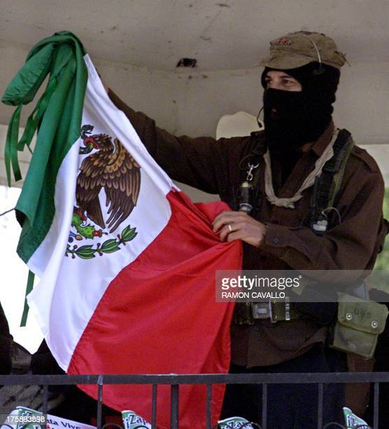 Insurgent leader Subcomandante Marcos raises the Mexican national flag during a demonstration held in Cuautla city in the State of Morelos Mexico 08...