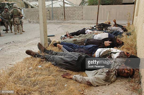 Insurgents killed by US Marines during the assault on Fallujah lie on the ground November 14 2004 in Iraq US and Iraqi forces continue to push their...