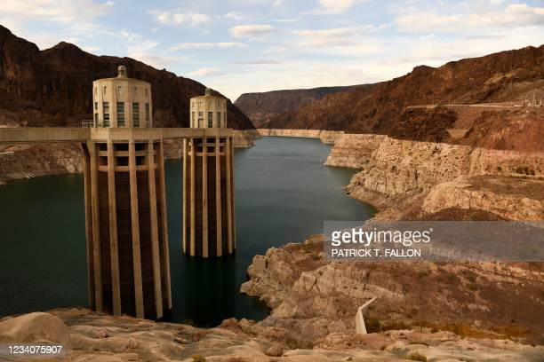 Intake towers for water to enter to generate electricity and provide hydroelectric power stand during low water levels due the western drought on...