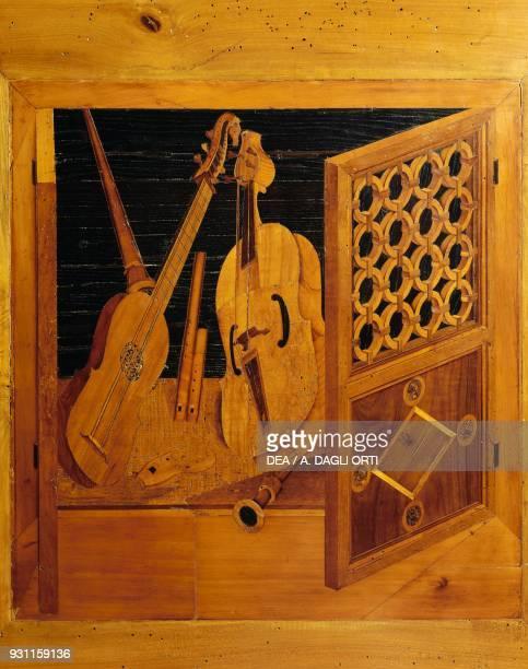 Intarsia depicting musical instruments by Paolo and Antonio Mola, Studiolo of Isabella d'Este, Palazzo Ducale , Mantua, Lombardy. Italy, 16th century.