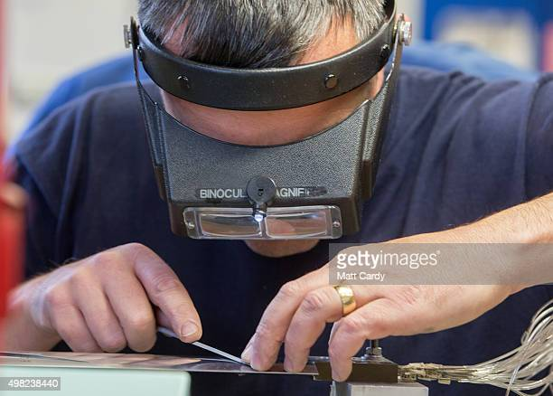 Integration engineers work on scale model aerofoils to be used for testing at the Airbus aircraft manufacturer's Filton site on November 19 2015 in...