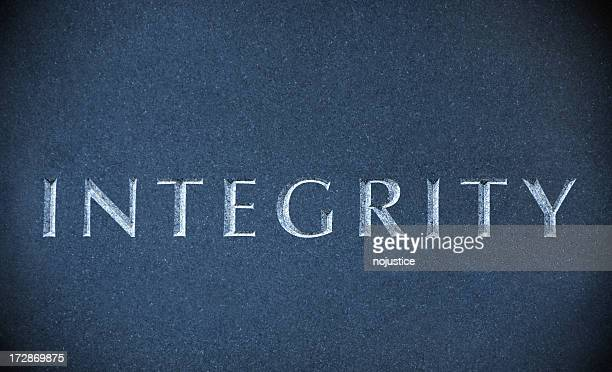 Integrity carved on a blue marble stone