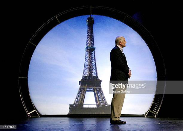 Intel CEO Craig Barrett stands near a projected image of the Eiffel Tower as he delivers a keynote address at the 2003 International Consumer...