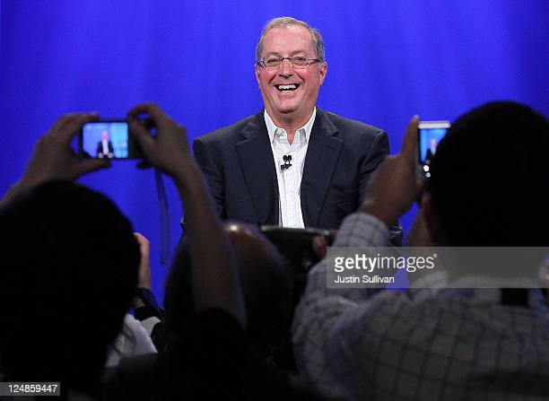 Intel CEO Paul Otellini laughs as photographers take pictures of him after he delivered a keynote address during the 2011 Intel Developer Forum at...