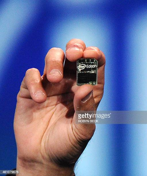 Intel Corp CEO Brian Krzanich introduces 'Intel Edison' a tiny Intelbased computer during his preshow keynote address at the 2014 International CES...