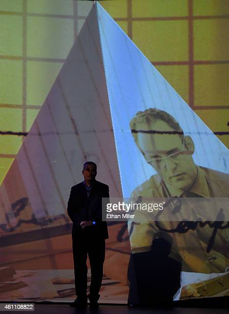 Intel Corp CEO Brian Krzanich stands on the side of the stage during a video tribute to Intel cofounder Gordon Moore during Krzanich's keynote...