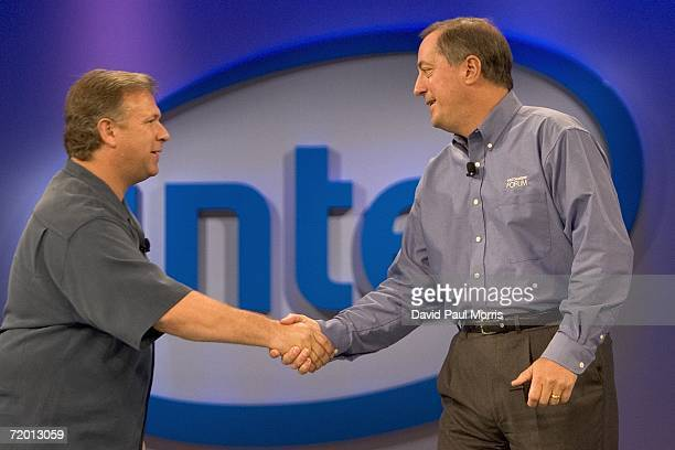 Intel Corporation CEO Paul Otellini and Phil Schiller senior vice president of worldwide marketing for Apple shake hands onstage at the opening of...