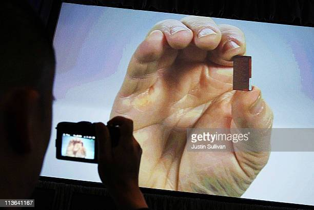 Intel Senior Fellow Mark Bohr holds a microprocessor in a video presentation during a news conference about the 3D TriGate transistors called 'Ivy...