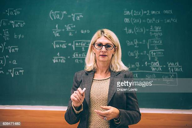 Intelligent female math professor in classroom