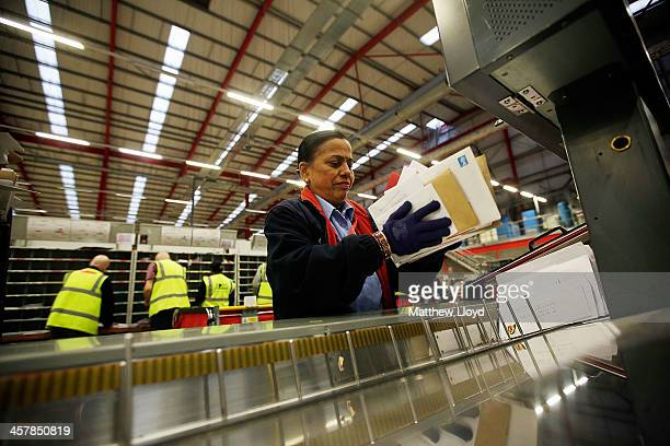 Intelligent letter sorting machines are loaded in the first step of the sorting process at Royal Mail's Swan Valley mail centre on December 18 2013...