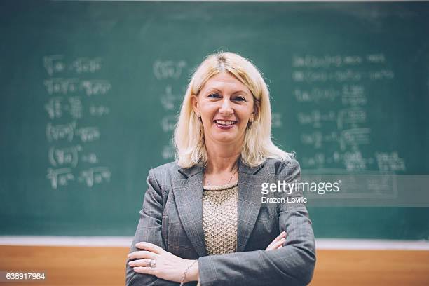 Intelligent matur female math professor in classroom