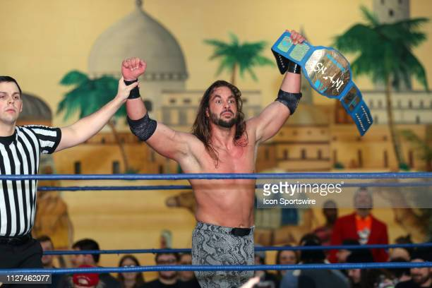 Intense champion Matthew Justice has his arm raised in victory during the Absolute Intense Wrestling event Hail to the King Baby on February 23 at...