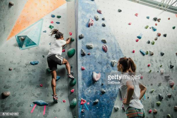 intense climbing session together - climbing stock pictures, royalty-free photos & images