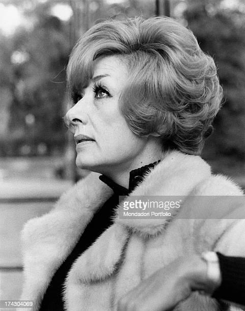 Intense closeup profile of the Italian film theatre and television actress Lauretta Masiero wearing an elegant light coloured mink coat Rome 1972