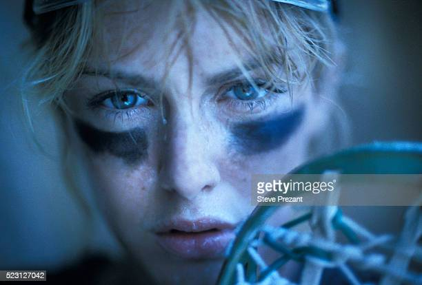 intense female lacrosse player - aggression stock pictures, royalty-free photos & images