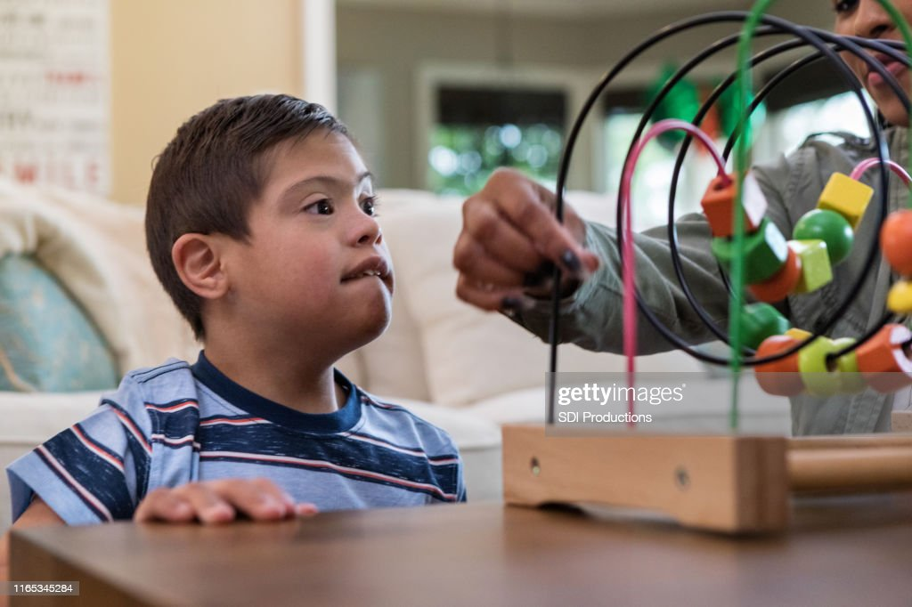 Intense Focus On Face Of Boy As Therapist Teaches Game High Res Stock Photo Getty Images