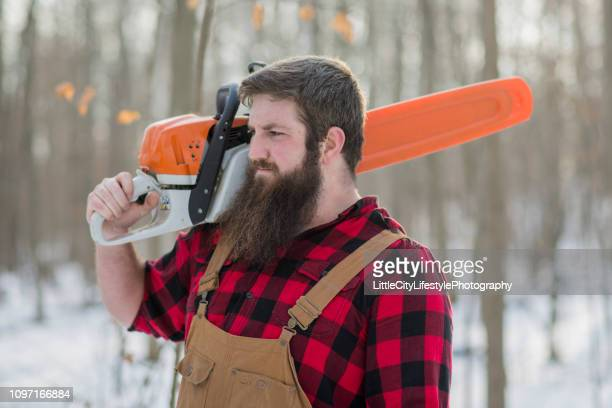 intense lumberjack - masculinity stock pictures, royalty-free photos & images