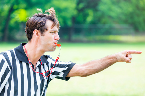Intense referee calls penalty during sporting event 585487984