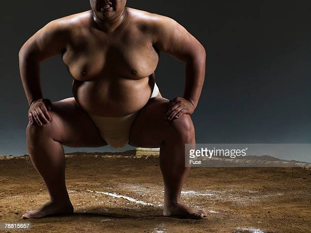 Intense Sumo Wrestler in Ring