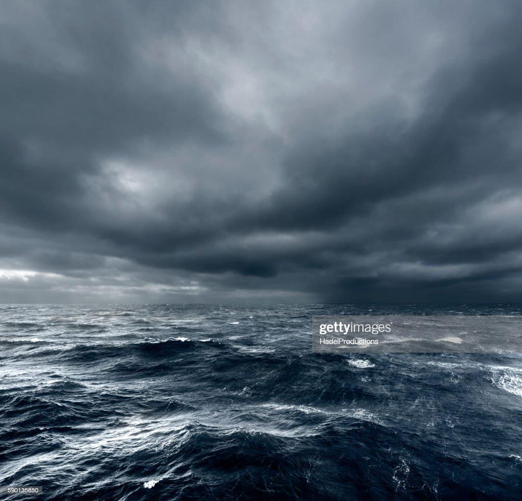 Intense thunderstorm rolling over open ocean : Stock Photo