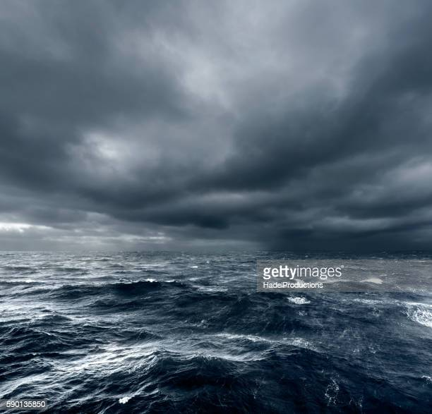 intense thunderstorm rolling over open ocean - meer stock-fotos und bilder