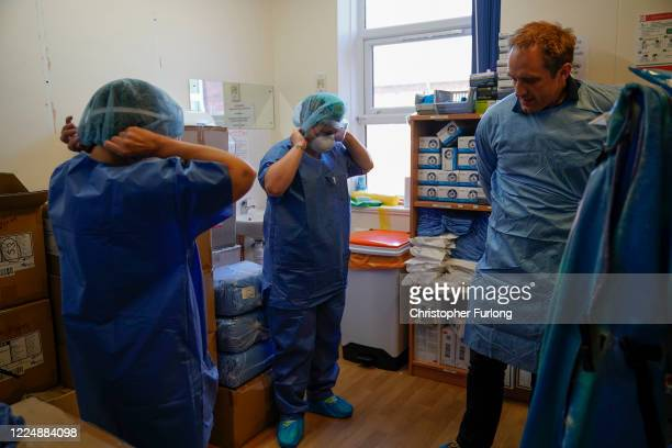 Intensive Care Unit staff don their personal protection equipmet before entering the Covid-19 ICU unit at Wrexham Maelor Hospital where staff have...