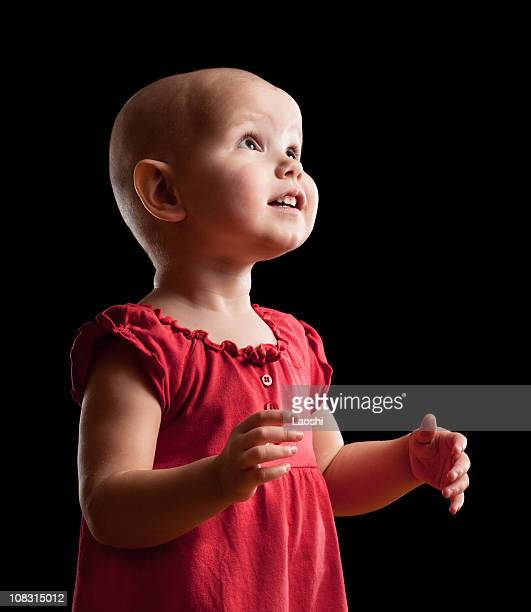 intent look - bald girl stock photos and pictures