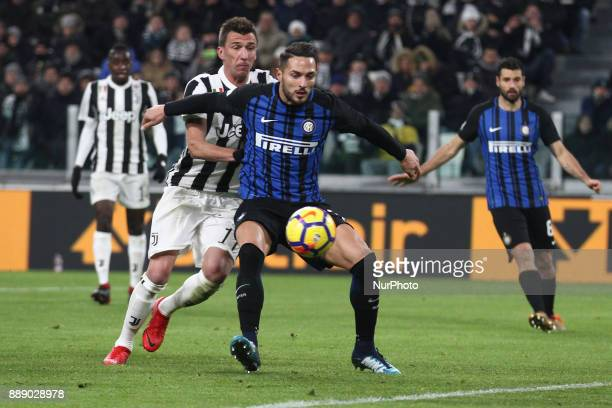 Inter defender Danilo D'Ambrosio fights for the ball against Juventus forward Mario Mandzukic during the Serie A football match n16 JUVENTUS INTER on...