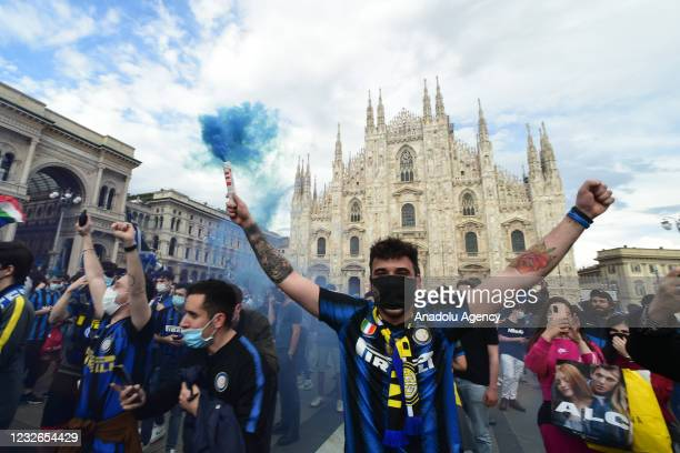Inter fans celebrate the victory of the 19th Serie A football championship in Piazza del Duomo, in Milan, Italy on May 02, 2021.