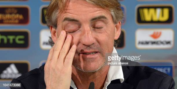 Inter Mailand's head coach Roberto Mancini speaks during the press conference in the Volkswagen arena in Wolfsburg Germany 11 March 2015...