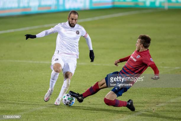 Inter Miami CF forward Gonzalo Higuain dribbles as FC Dallas defender Bressan slides in for a tackle during the game between FC Dallas and Inter...