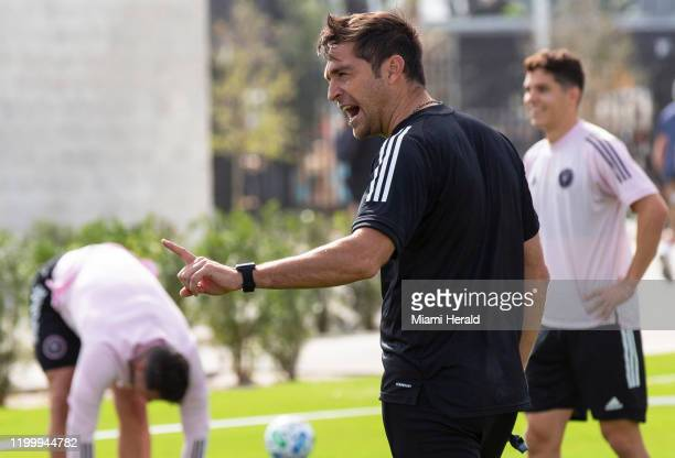 Inter Miami CF head coach Diego Alonso speaks to hhihs players on the field during Inter Miami's first practice at their new training site former...