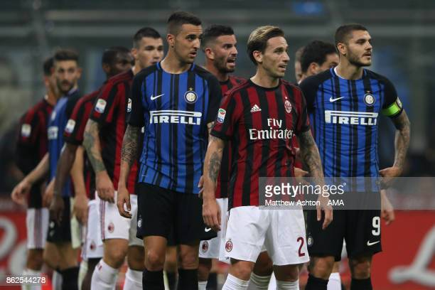 Inter Milan and AC Milan players await a free kick in the Milan Derby during the Serie A match between FC Internazionale and AC Milan at Stadio...
