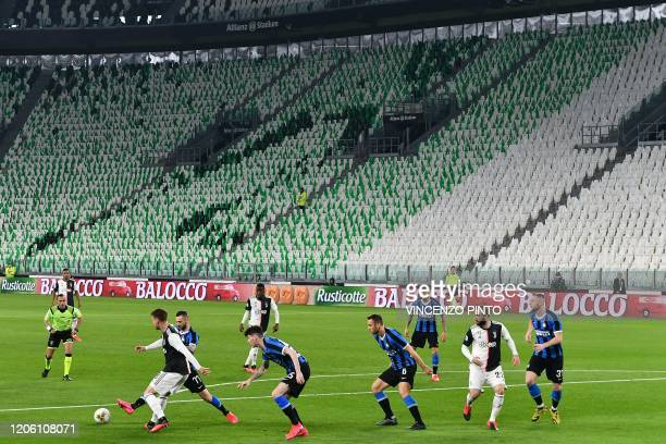 TOPSHOT Inter Milan and Juventus players compete in an empty stadium due to the novel coronavirus outbreak during the Italian Serie A football match...